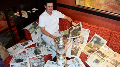 Justin Rose admires the Monday headlines declaring his US Open victory. [Getty Images]