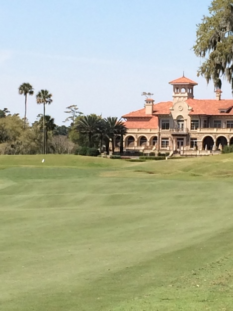 The clubhouse and 18th green from the 18th fairway.