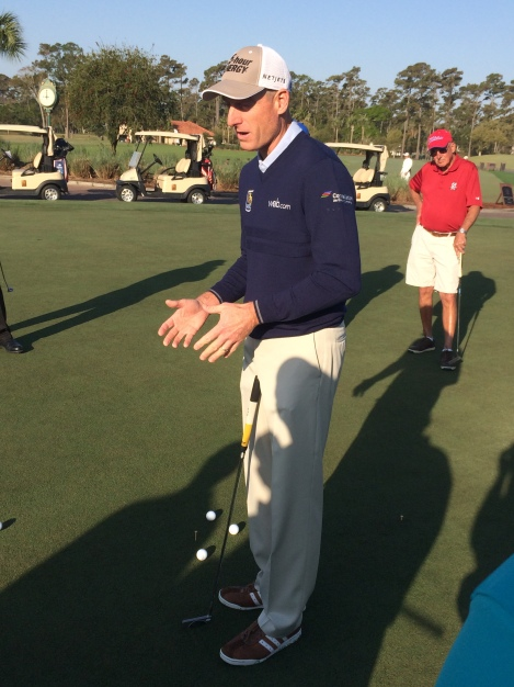 Furyk sharing the finer points of putting.